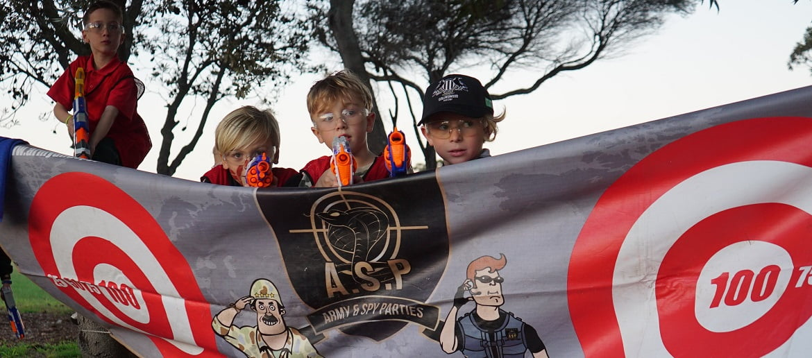 Children at army themed birthday NERF War party