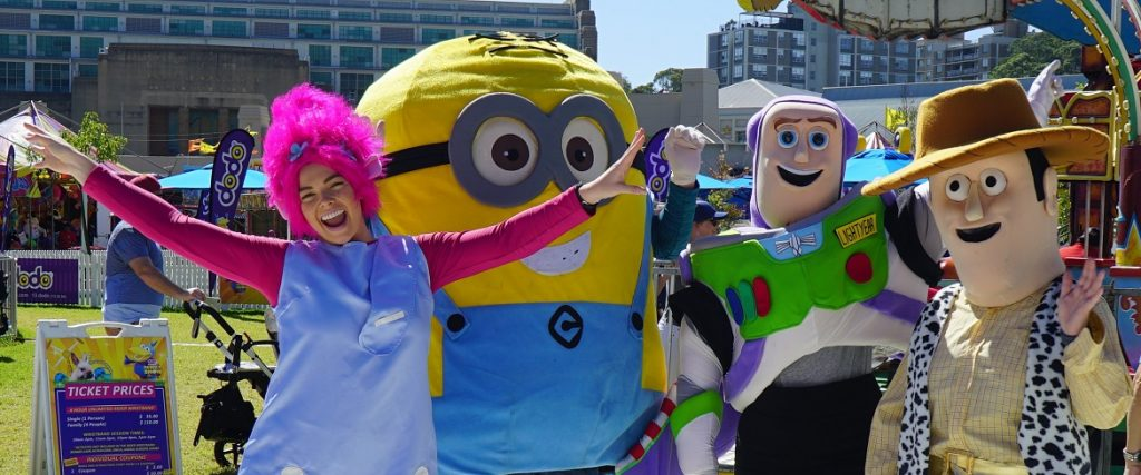 image of corporate event roving entertainers Poppy Troll, Minion, Buzz Lightyear, Woody the Cowboy