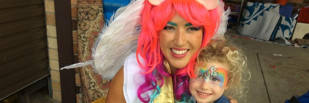 image of Princess Celestia Unicorn birthday party entertainer with smiling child