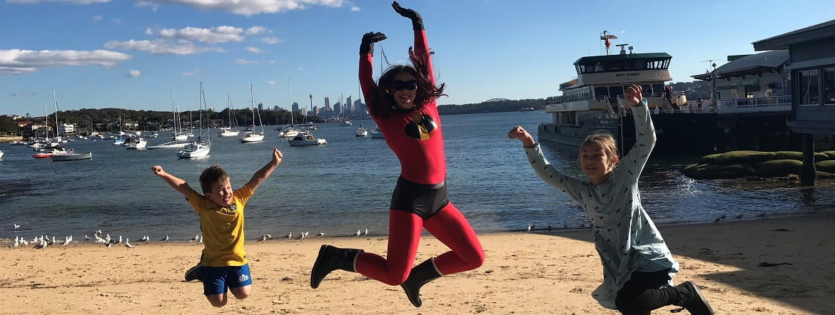 image of kids party entertainer Mrs Incredible at a Birthday party entertainer with children at the beach